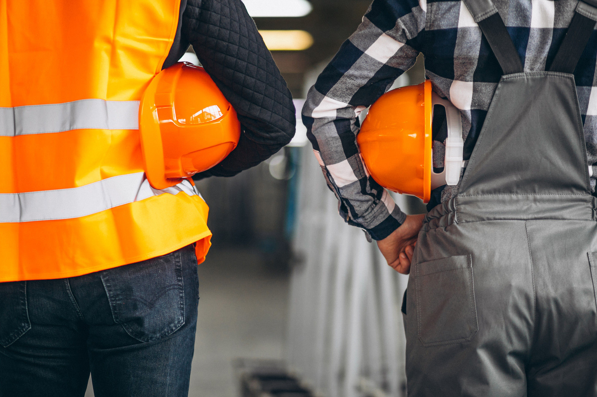 two engineers holding hard hats