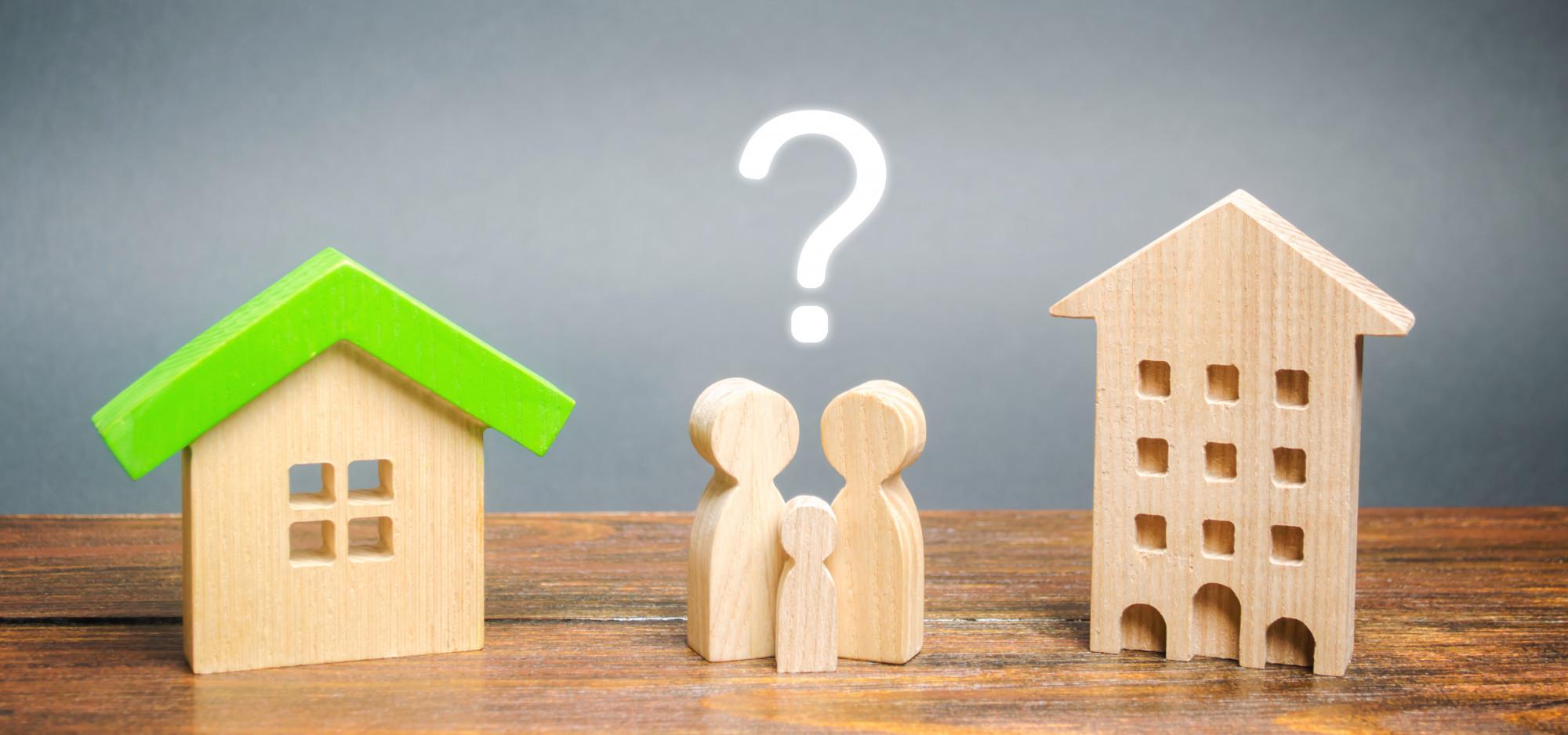 wooden model of family choosing home