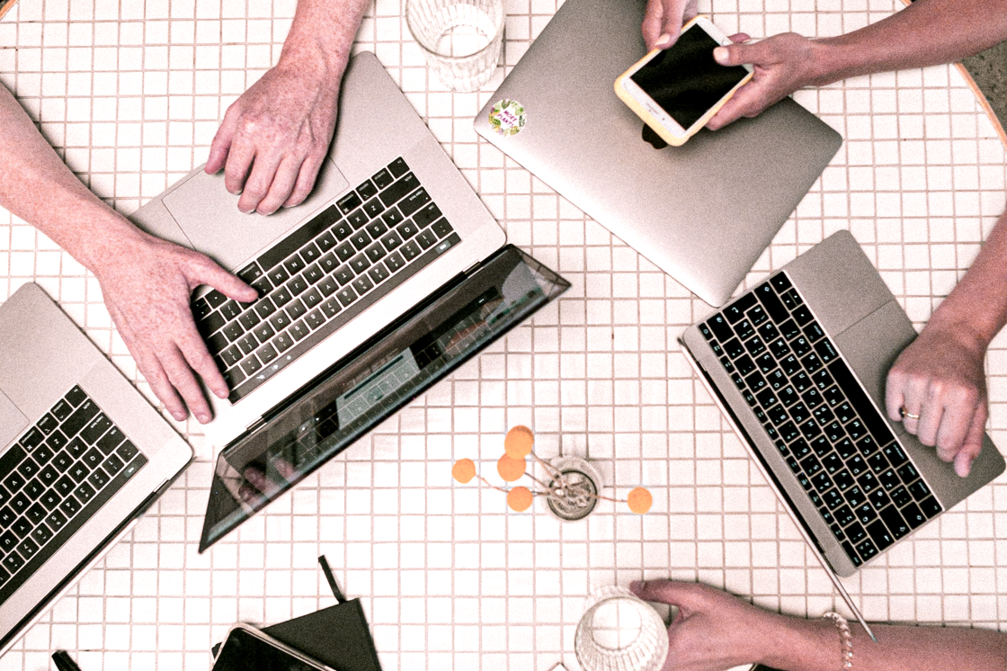 group of people working with their laptop