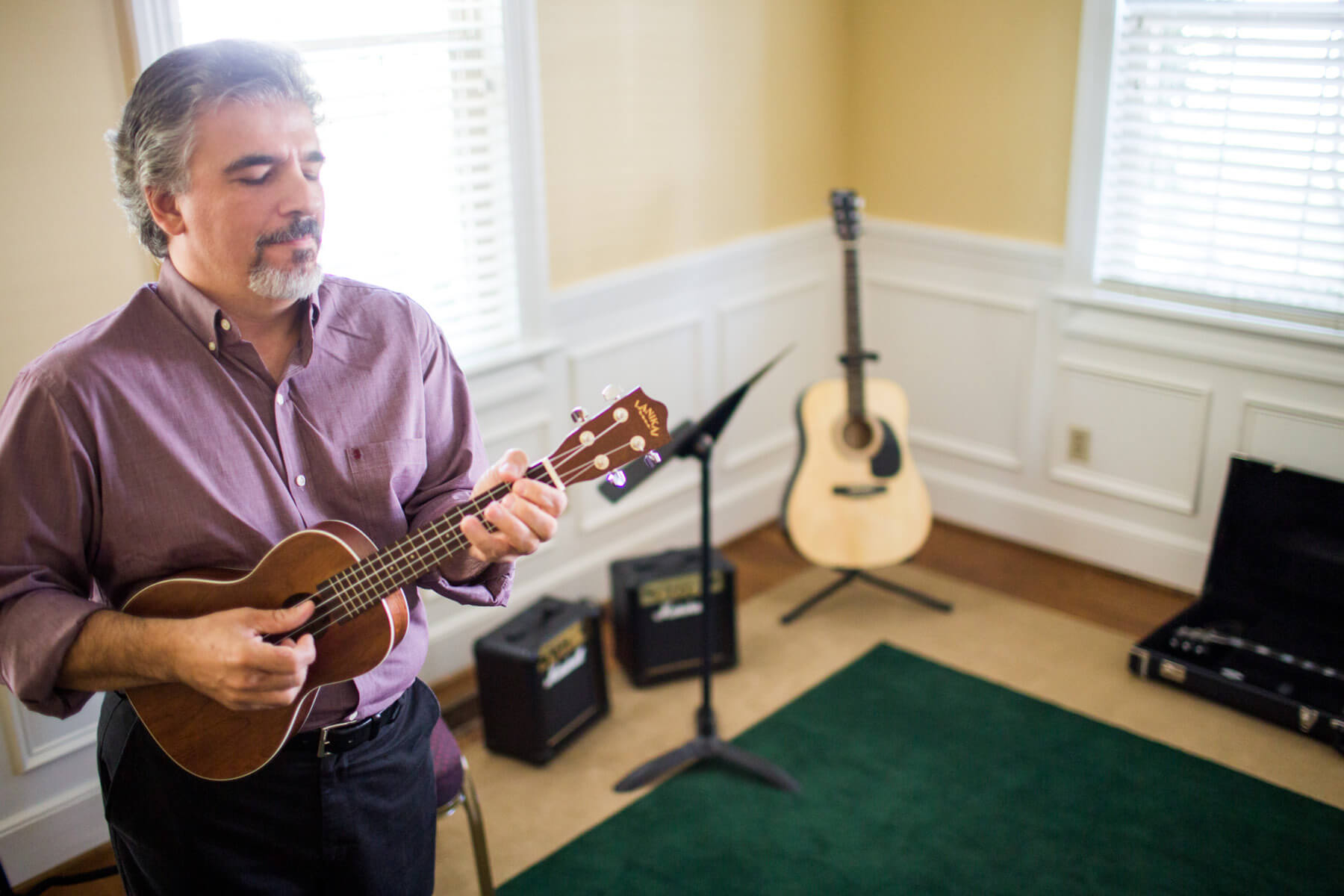 Man plays ukulele at Irmo Music Academy