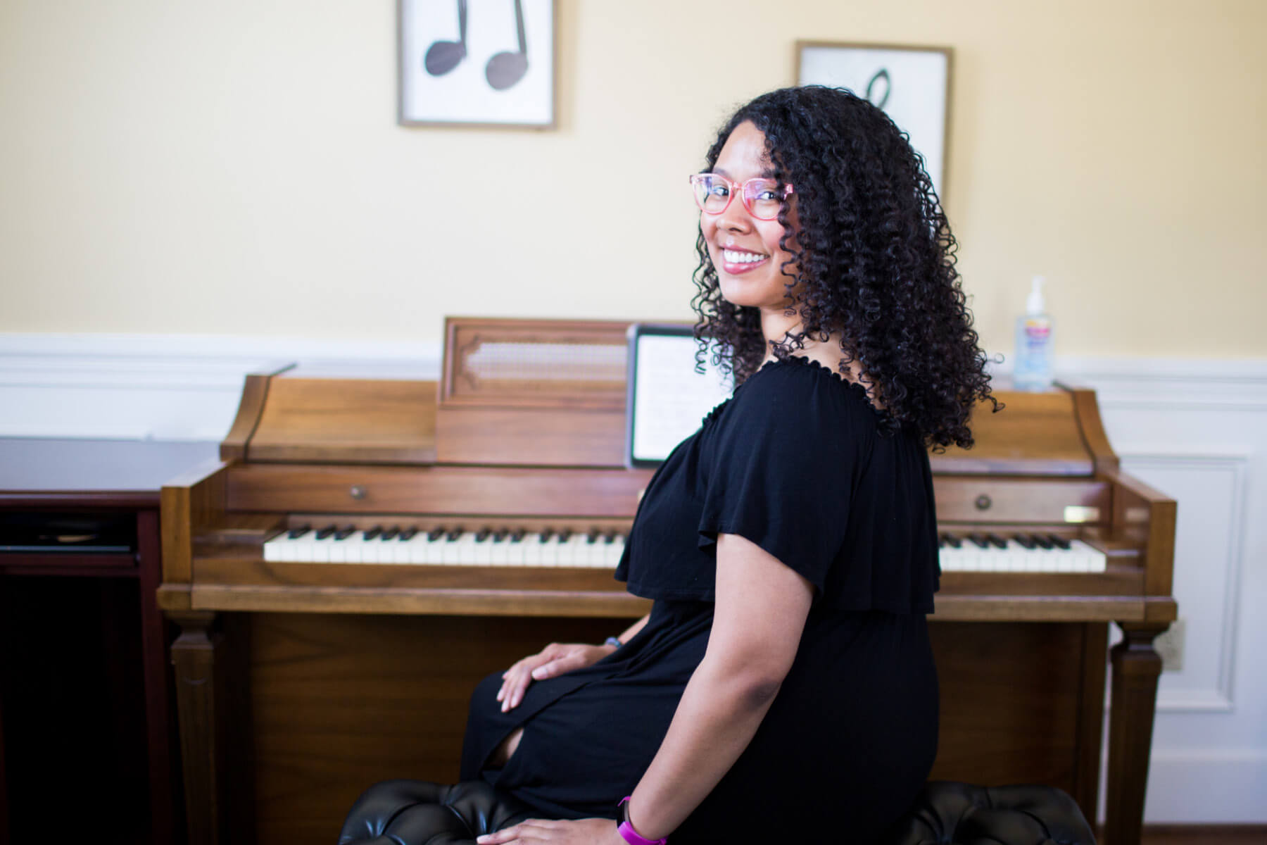 Piano instructor, looking over her shoulder.
