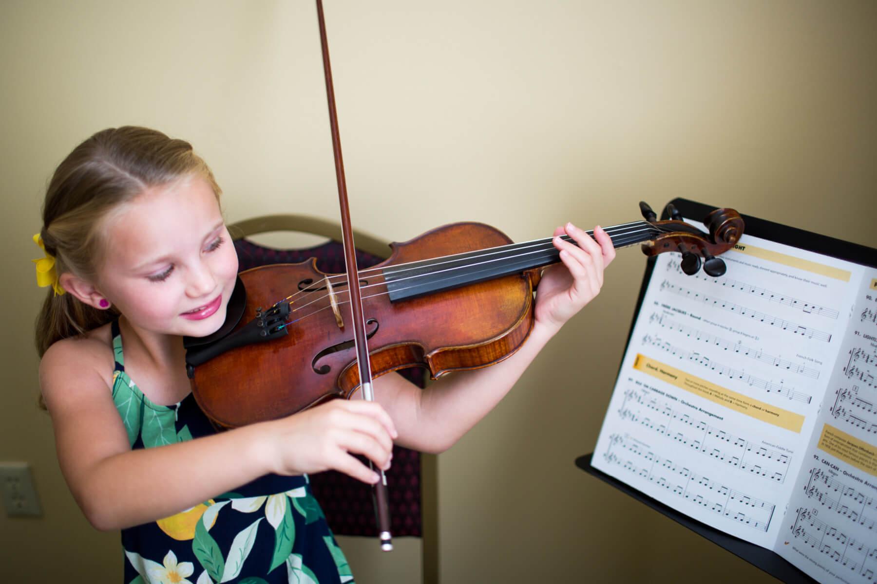 Student plays violin at Irmo Music Academy.