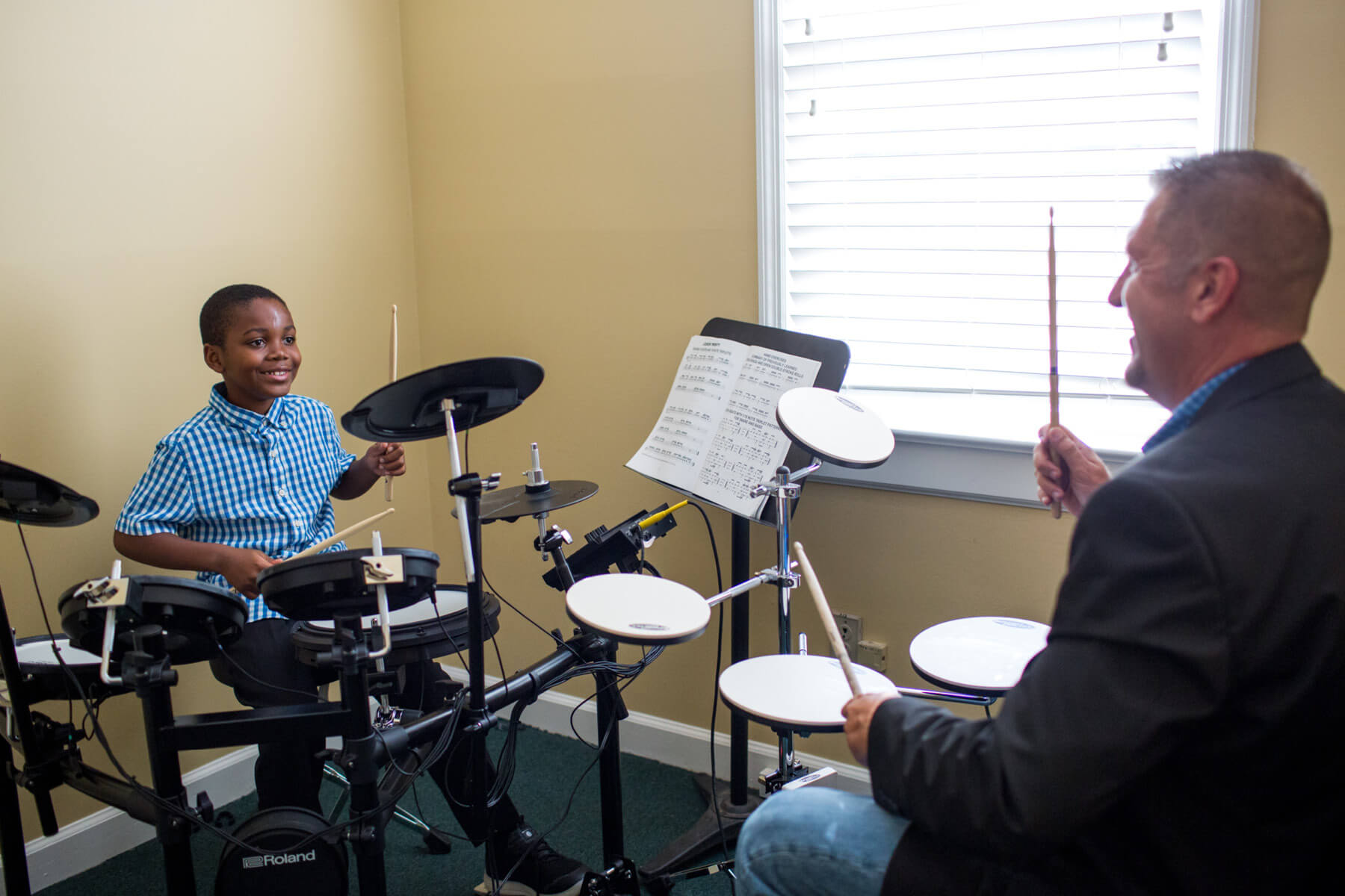 Student and instructor during drum lesson.