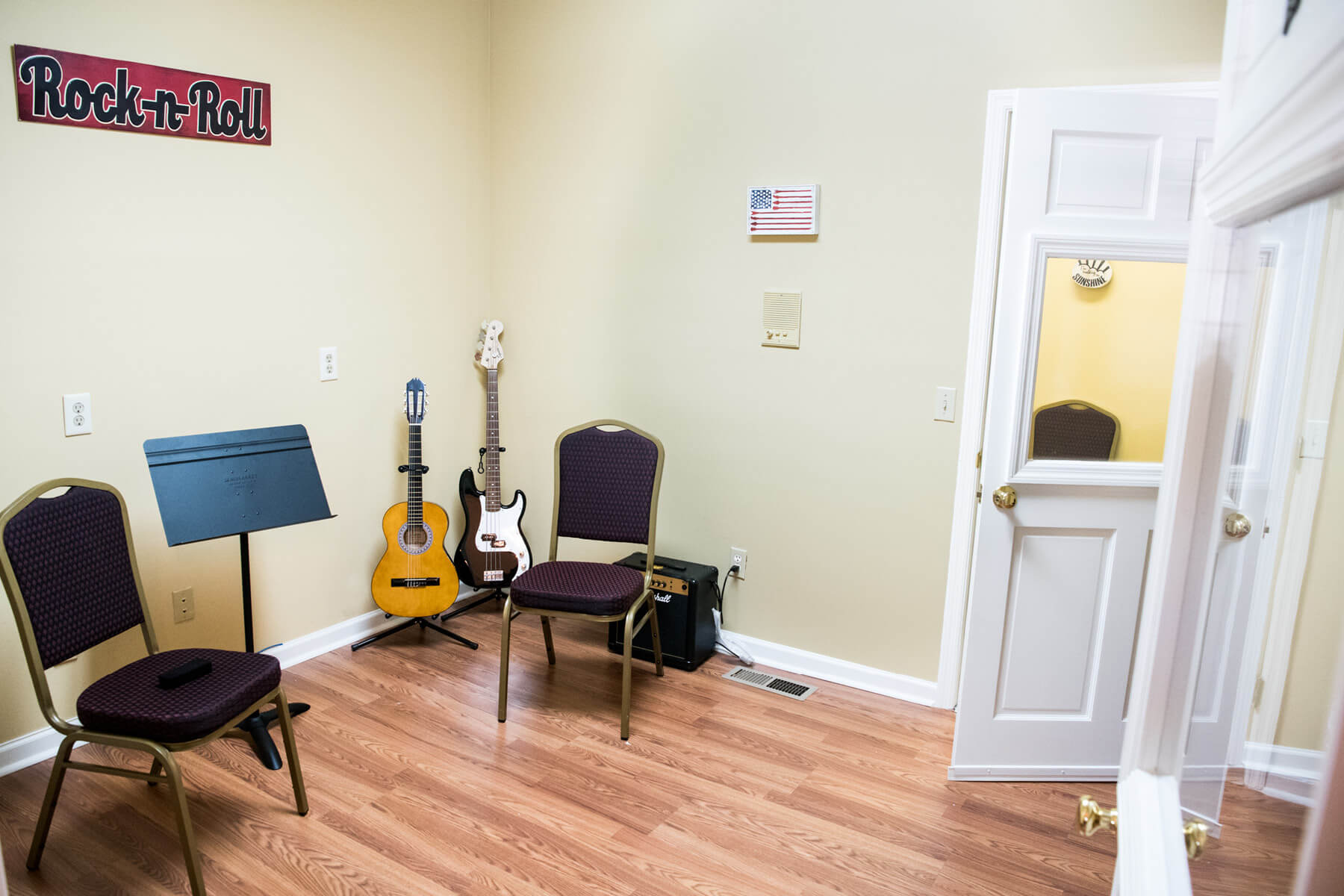 Irmo Music Academy Guitar lesson room with Rock n Roll Banner