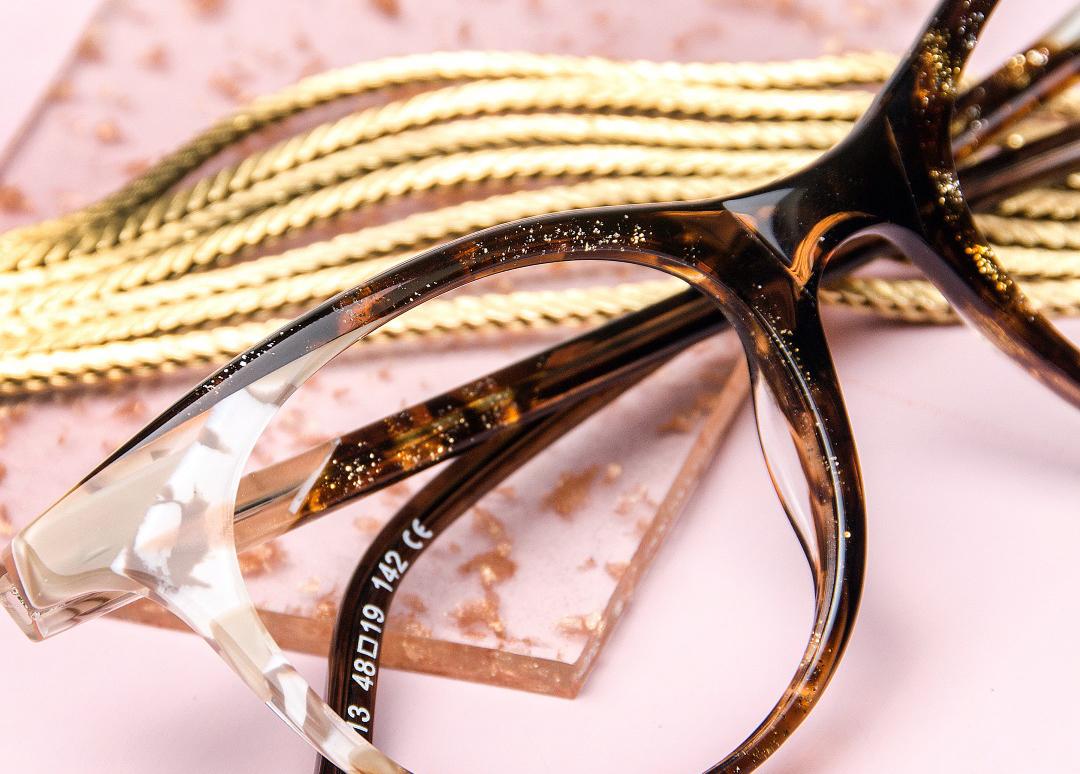 Elegant glasses on a pink background