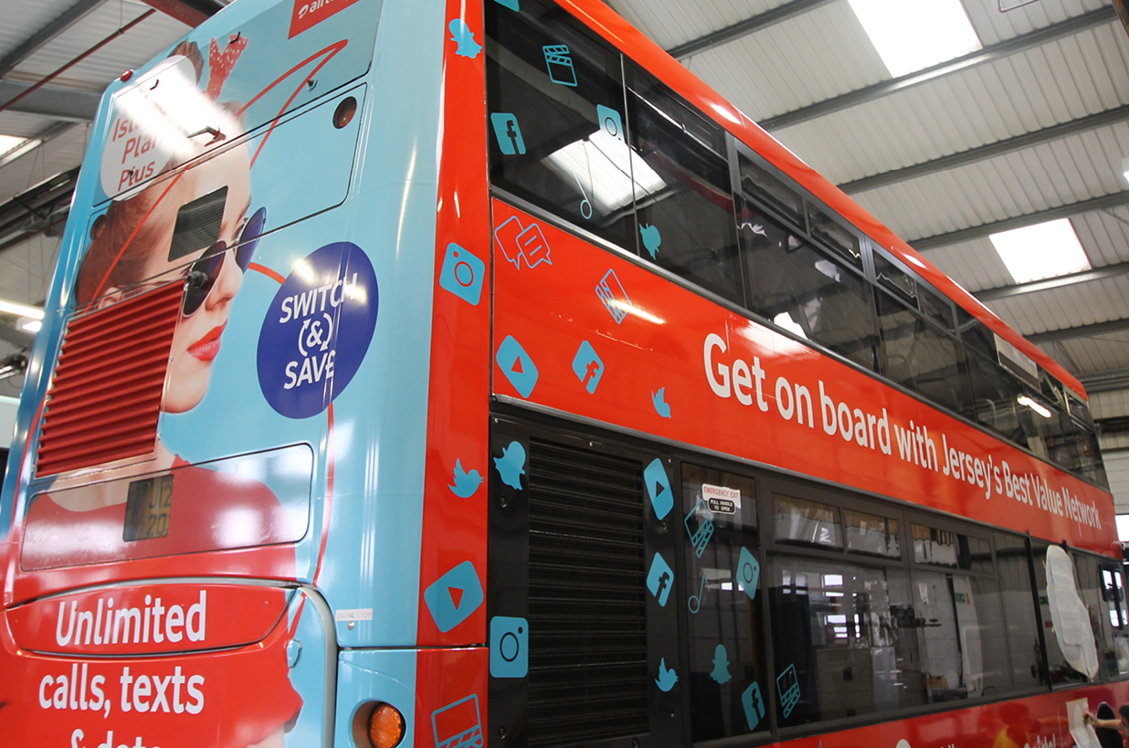 Double decker full wrap advert for Airtel Vodafone
