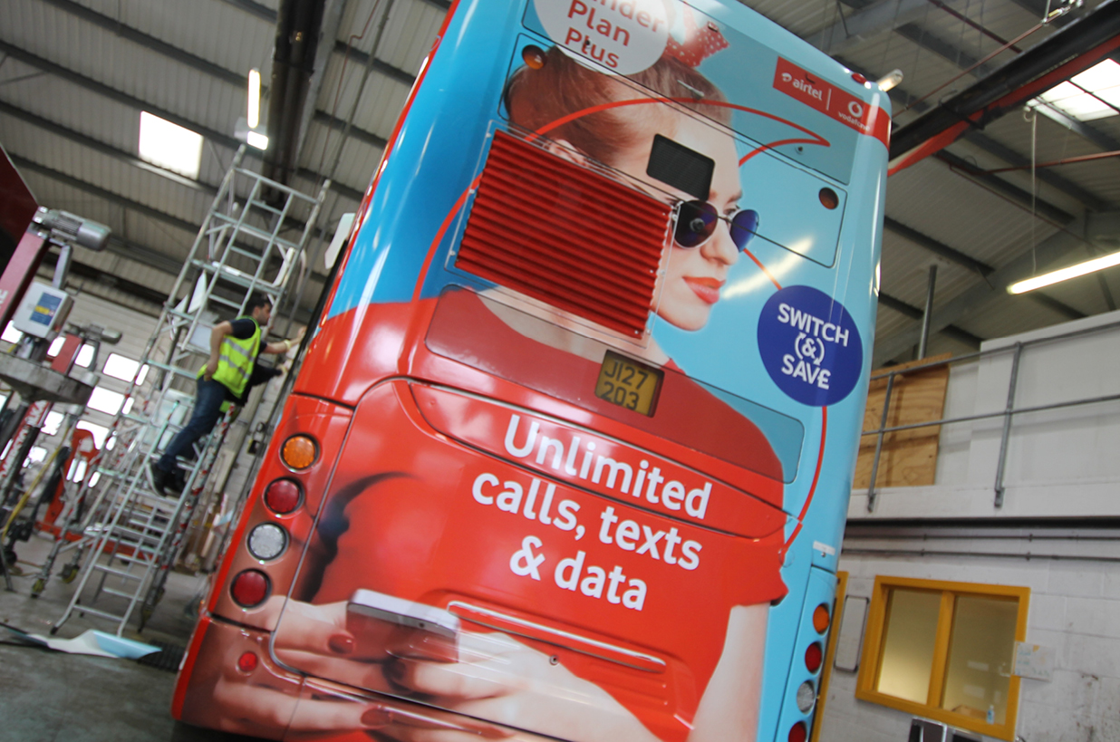 Double decker full wrap advert for Airtel Vodafone (full rear)