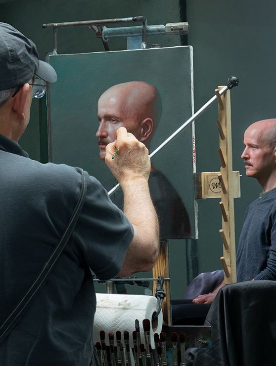 Marvin Mattelson doing a demo painting from a live model.