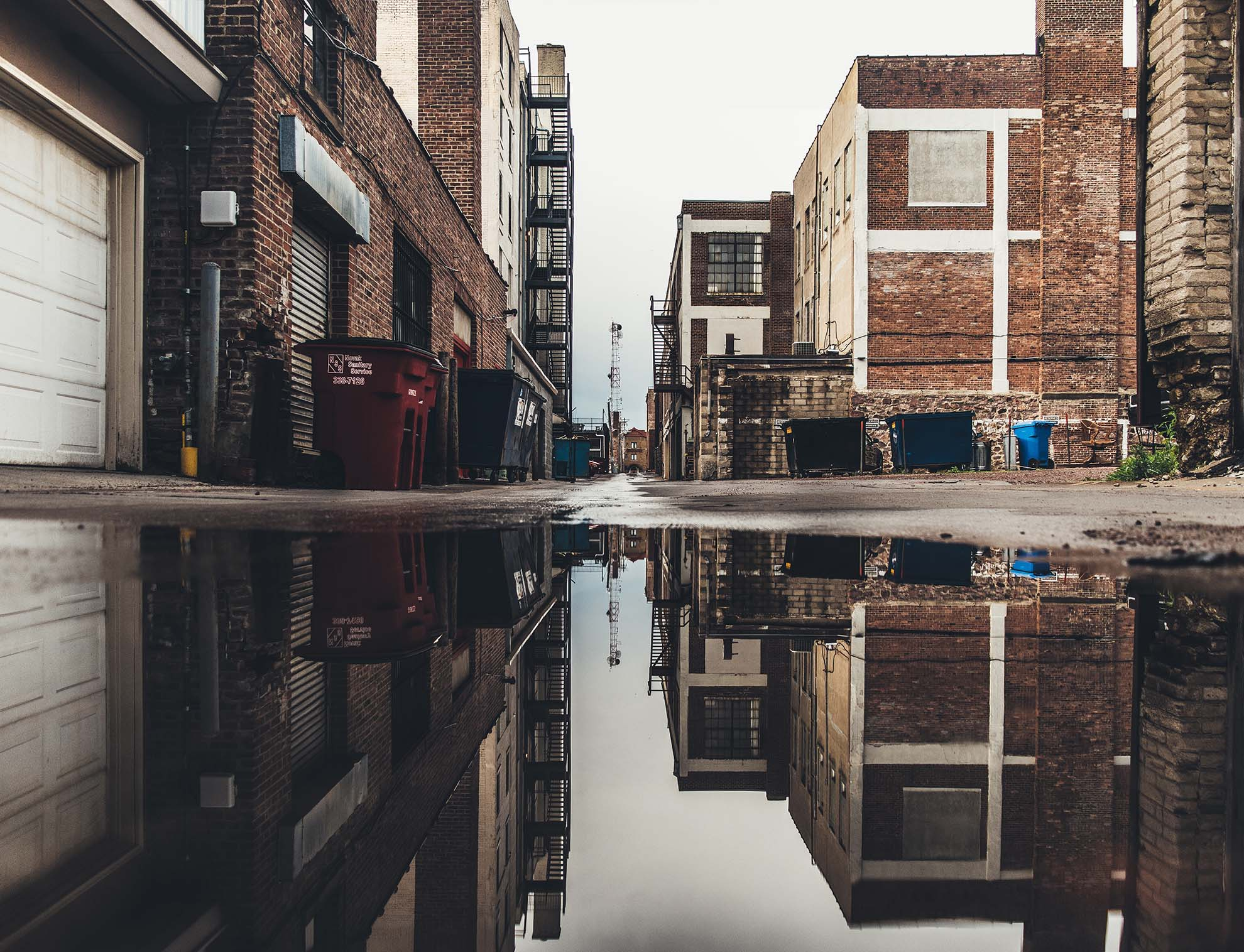 A photo of a back alley in an urban setting