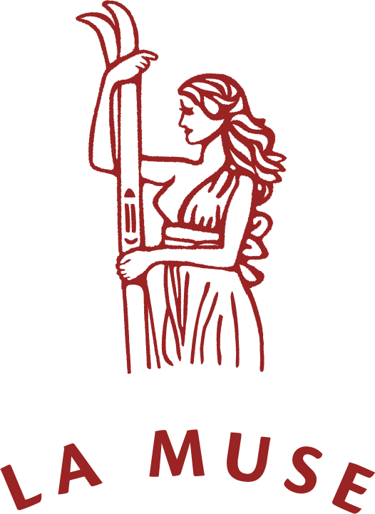 "Logo of a woman holding a pair of skis above the text ""The Muse"" written in an arc of a circle"