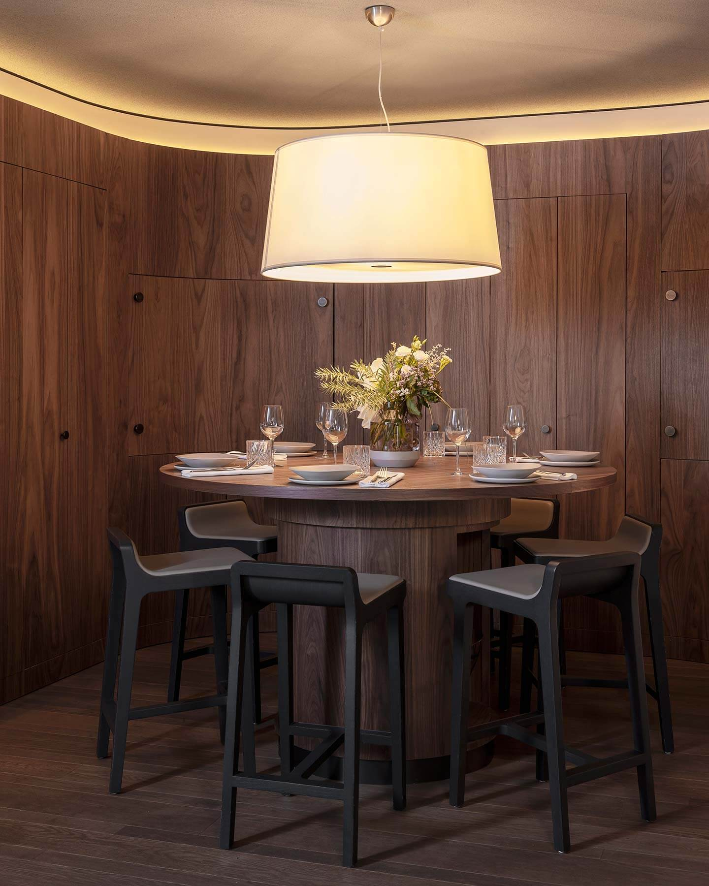 Dark wood round high table, stools and large hanging lamp