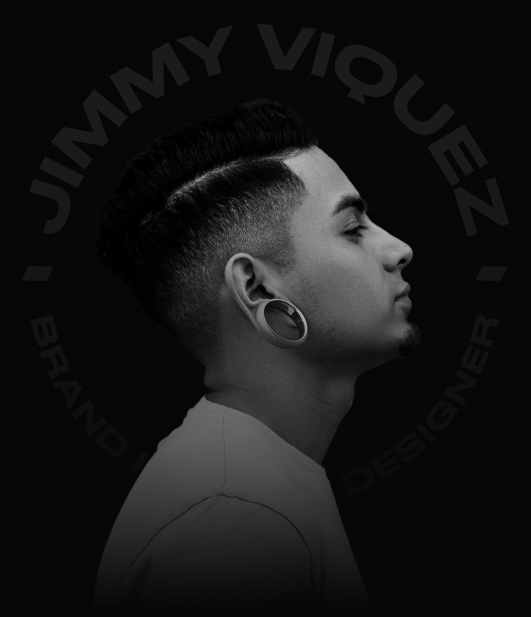 Side portrait of Jimmy Viquez, a brand identity graphic designer.