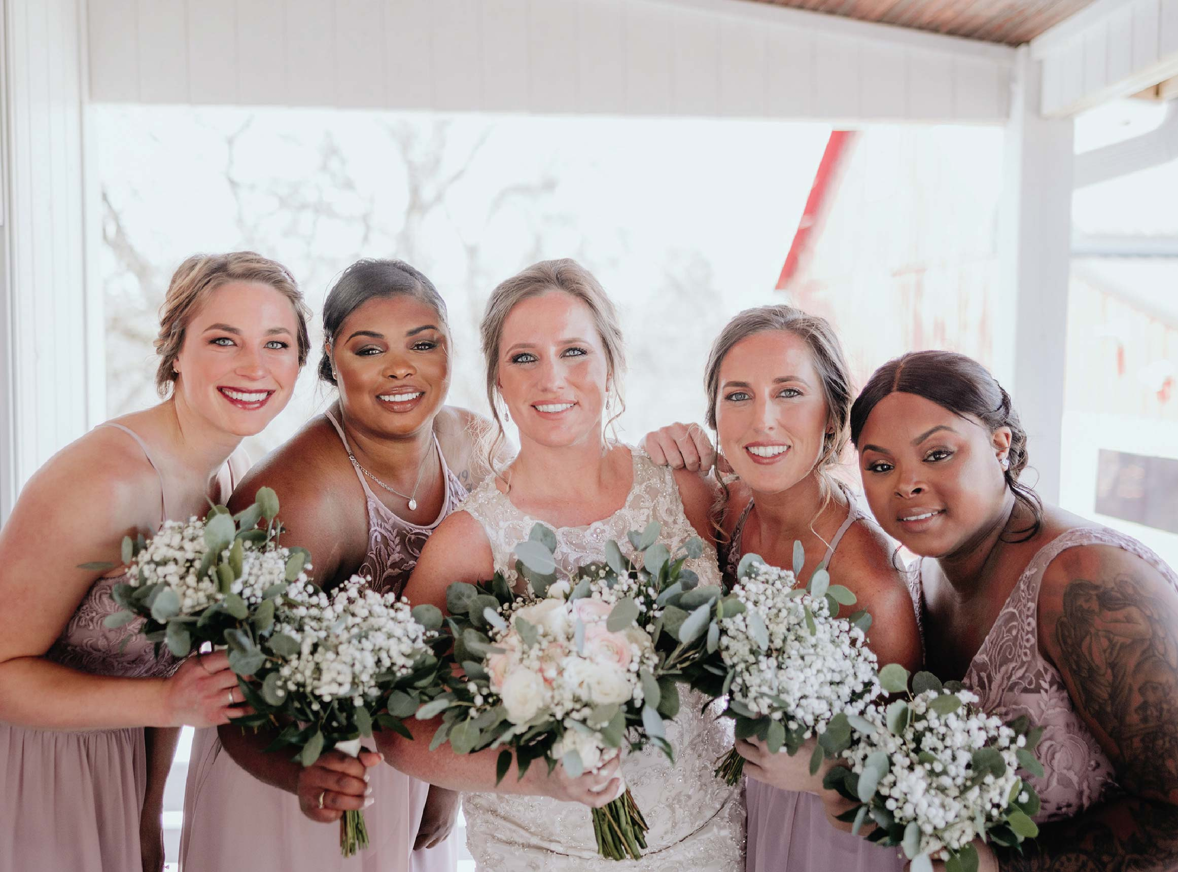 Bride and bridesmaids with makeup by Brittney Ross MUA
