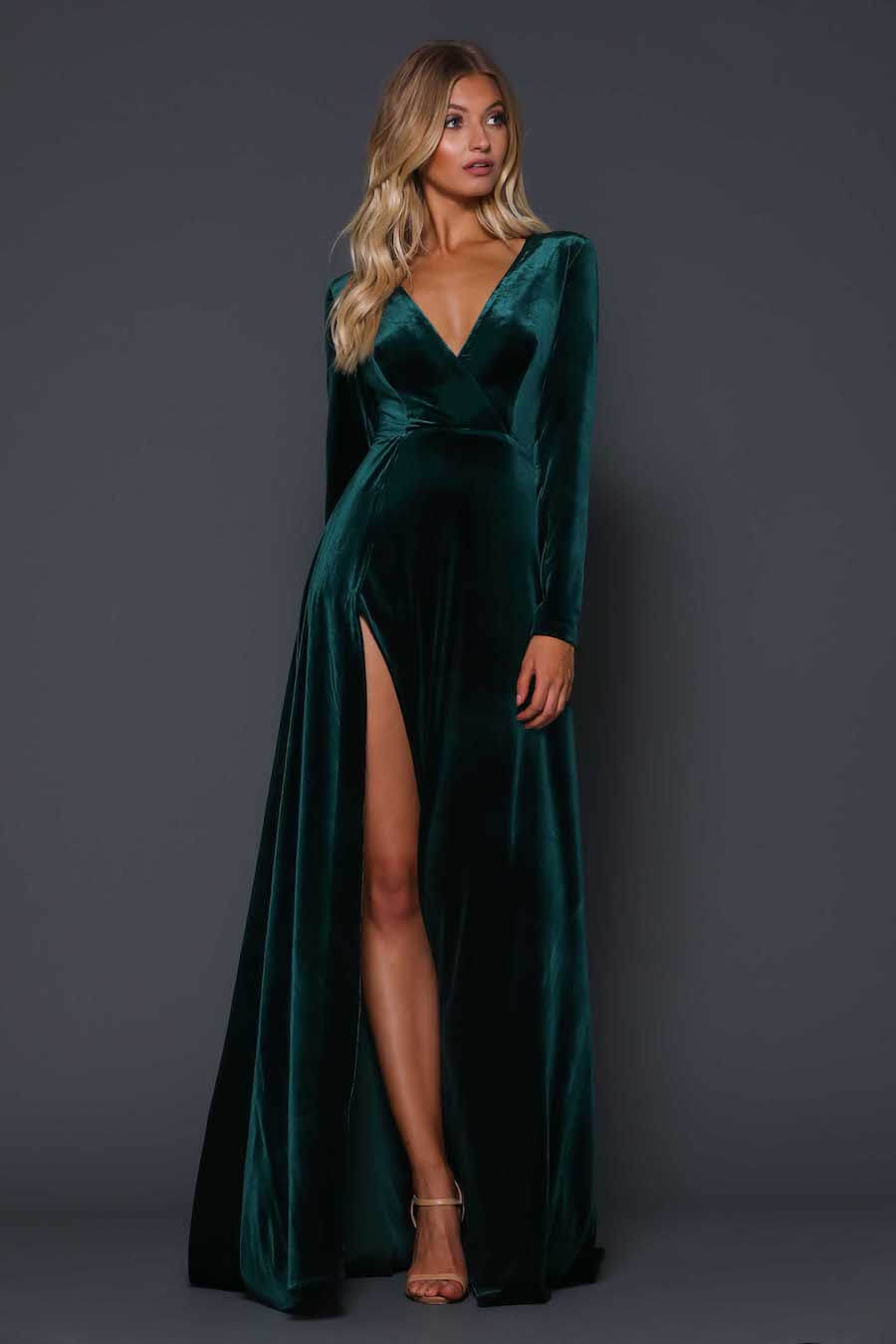 Plunging neckline velvet fitted dress with long sleeves and high split