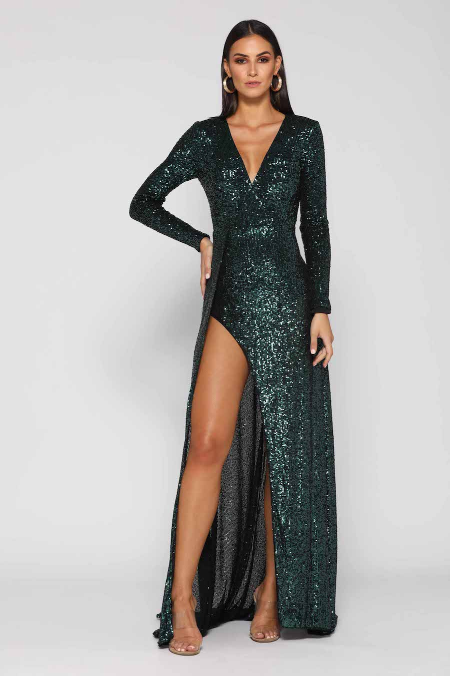 Stunning V neck long sleeve sequinned gown with high split.