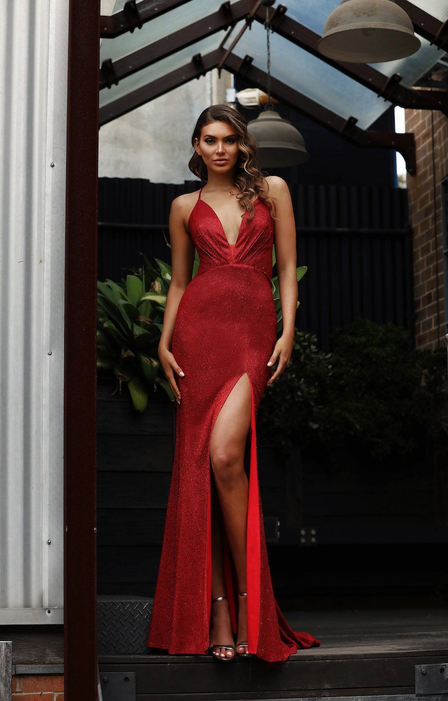 Low cut full length gown in shimmer fabric with lace up back and front split