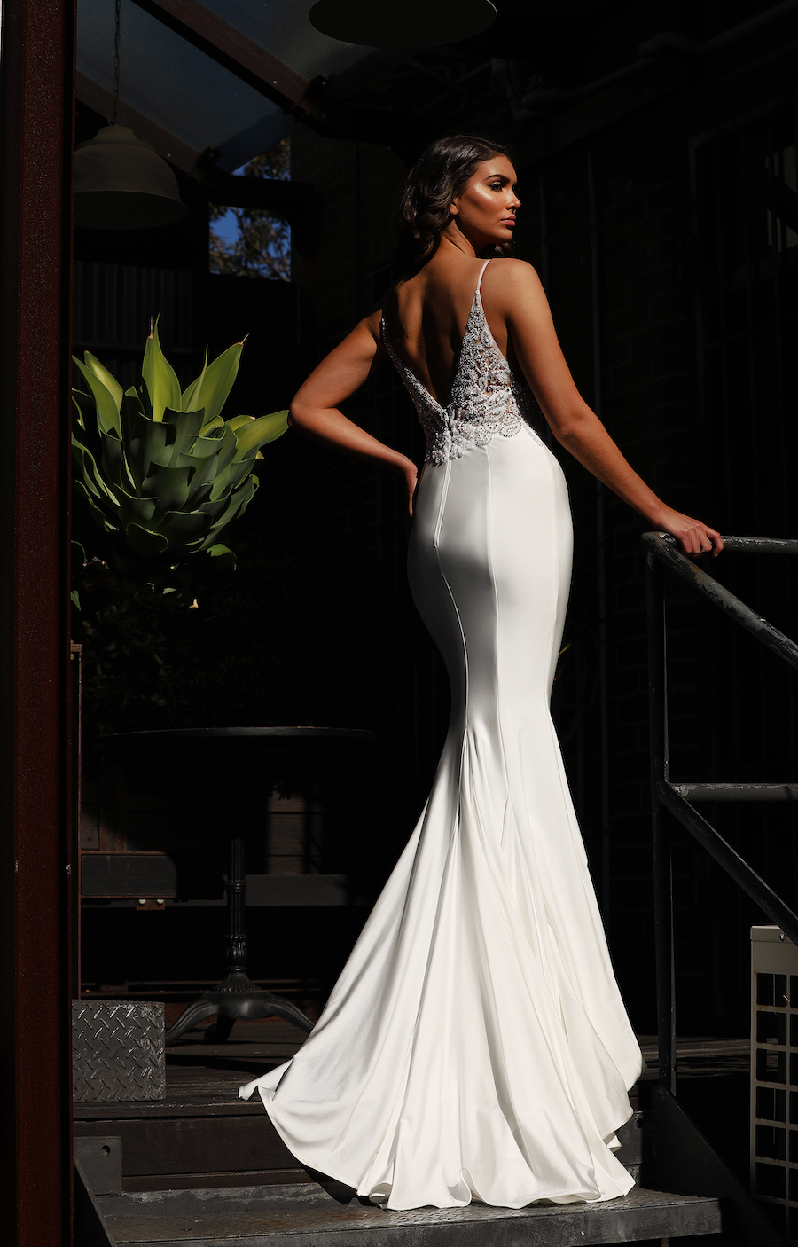 Spectacular gown with beaded bodice with a fishtale skirt.