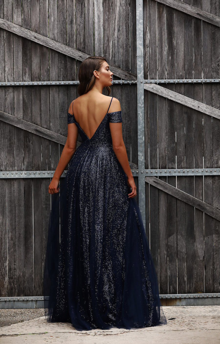 Shimmering off the shoulder dress with ballgown skirt.