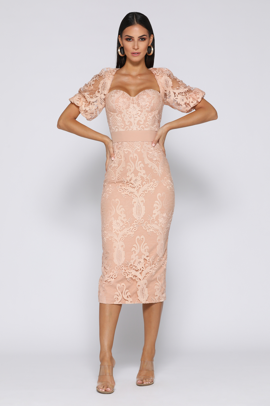 Lace dress features puffed sleeves and waist belt.