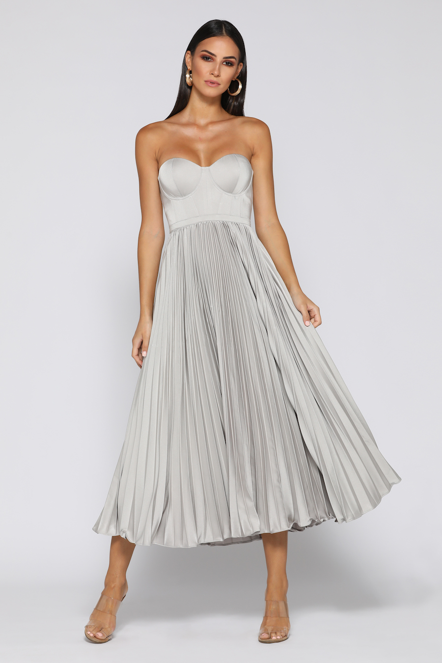 Strapless bodice dress with fluid pleated skirt
