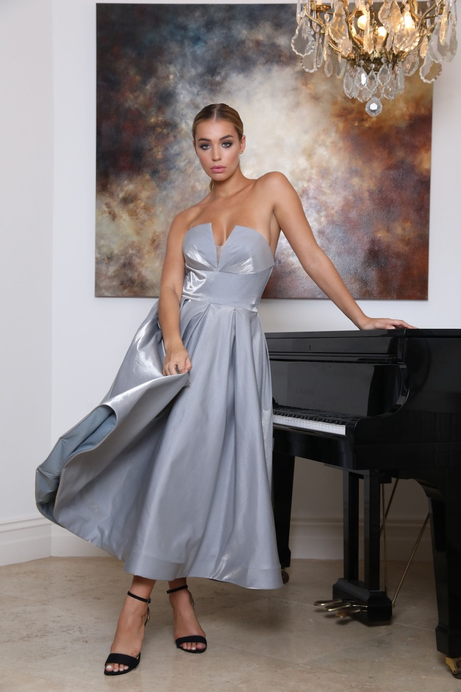 Strapless dress with fitted bodice and full tea length skirt