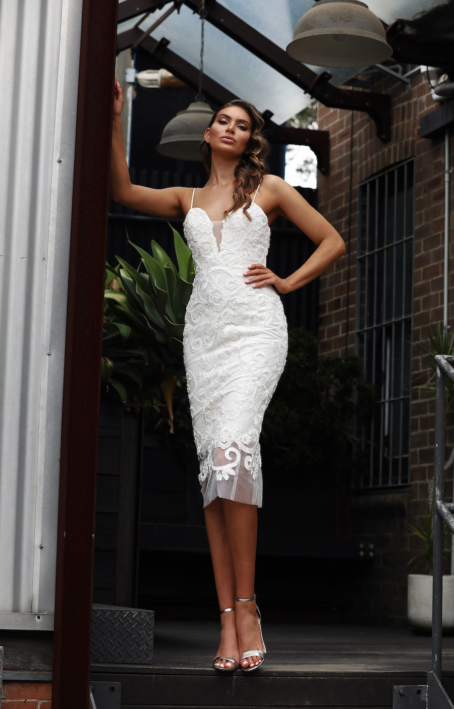 Beautiful off the shoulder foil dress with sweetheart neckline and front split.