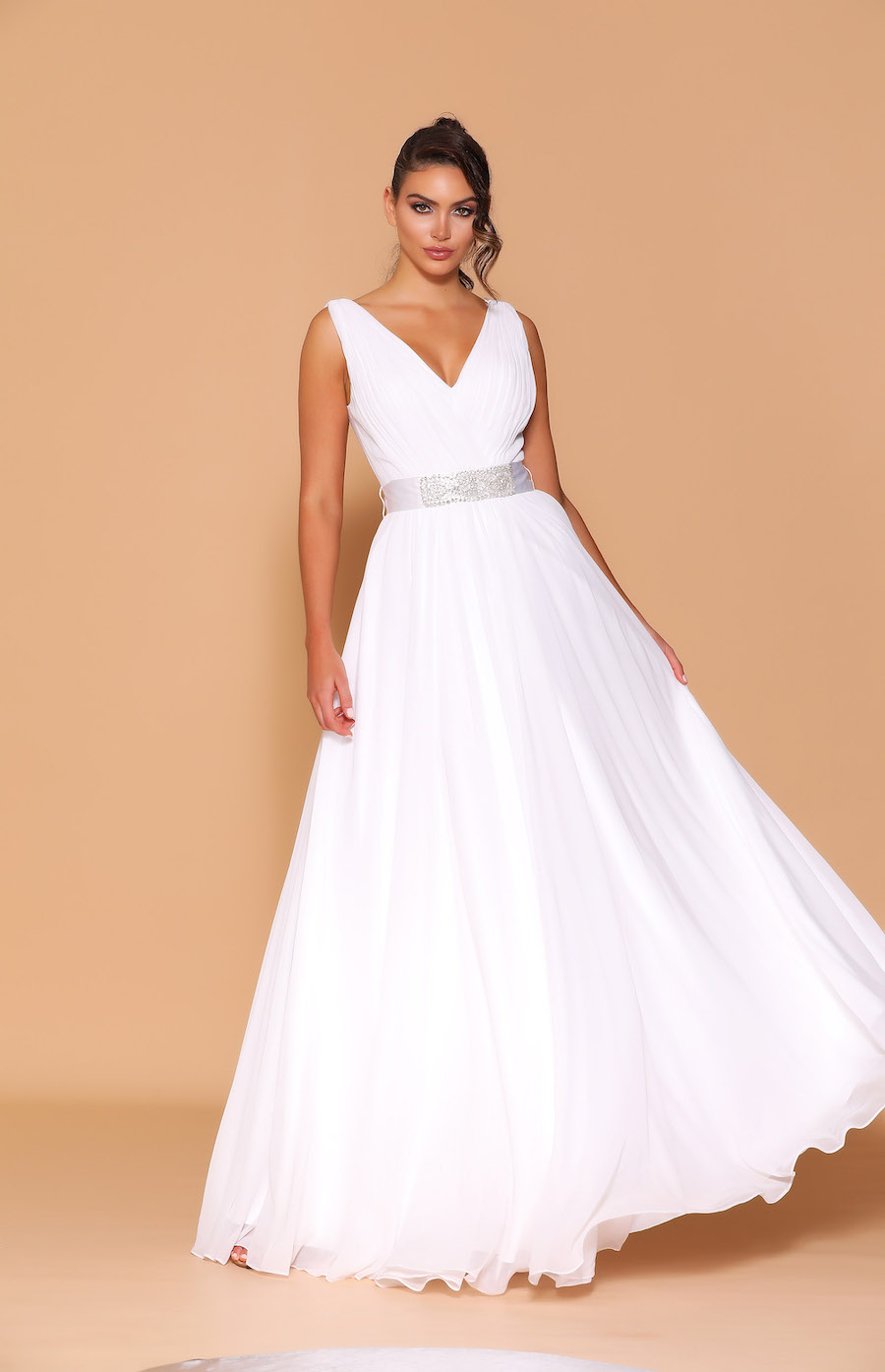 White chiffon dress with pleated bodice, full skirt and diamante belt