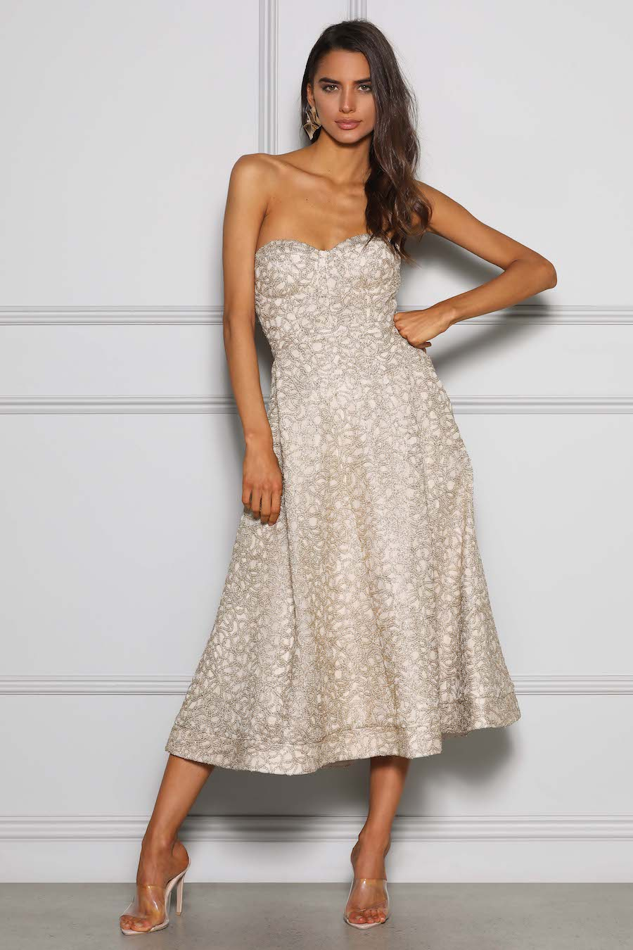 A line bustier dress with intricate gold lace