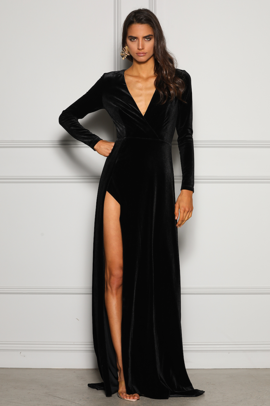 Beautiful full length dress with long sleeves featuring a deep v neckline and high split in soft velvet