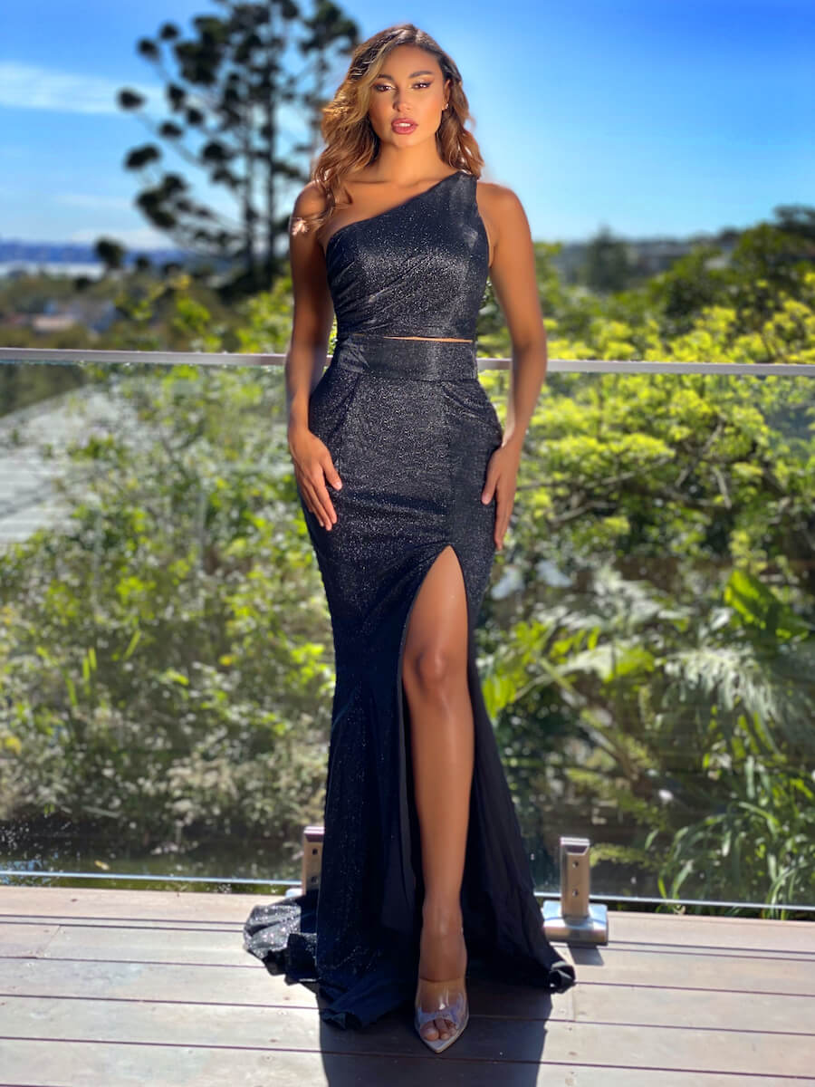 Two-piece gown with one shoulder crop top and high waisted skirt with side split and small train