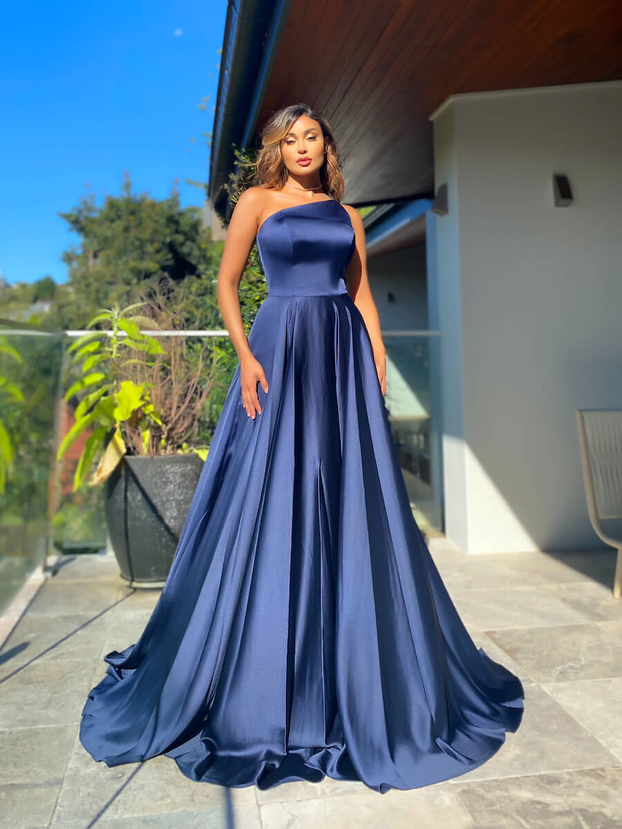 Classic one-shoulder ball gown with a fitted bodice and full skirt