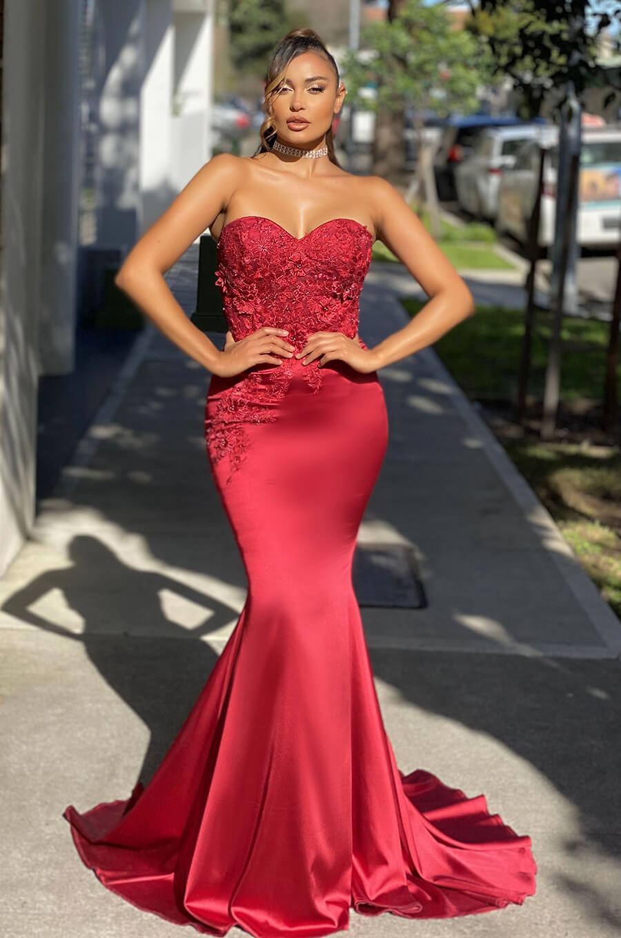 Fitted mermaid style gown with floral applique and sheer paneling