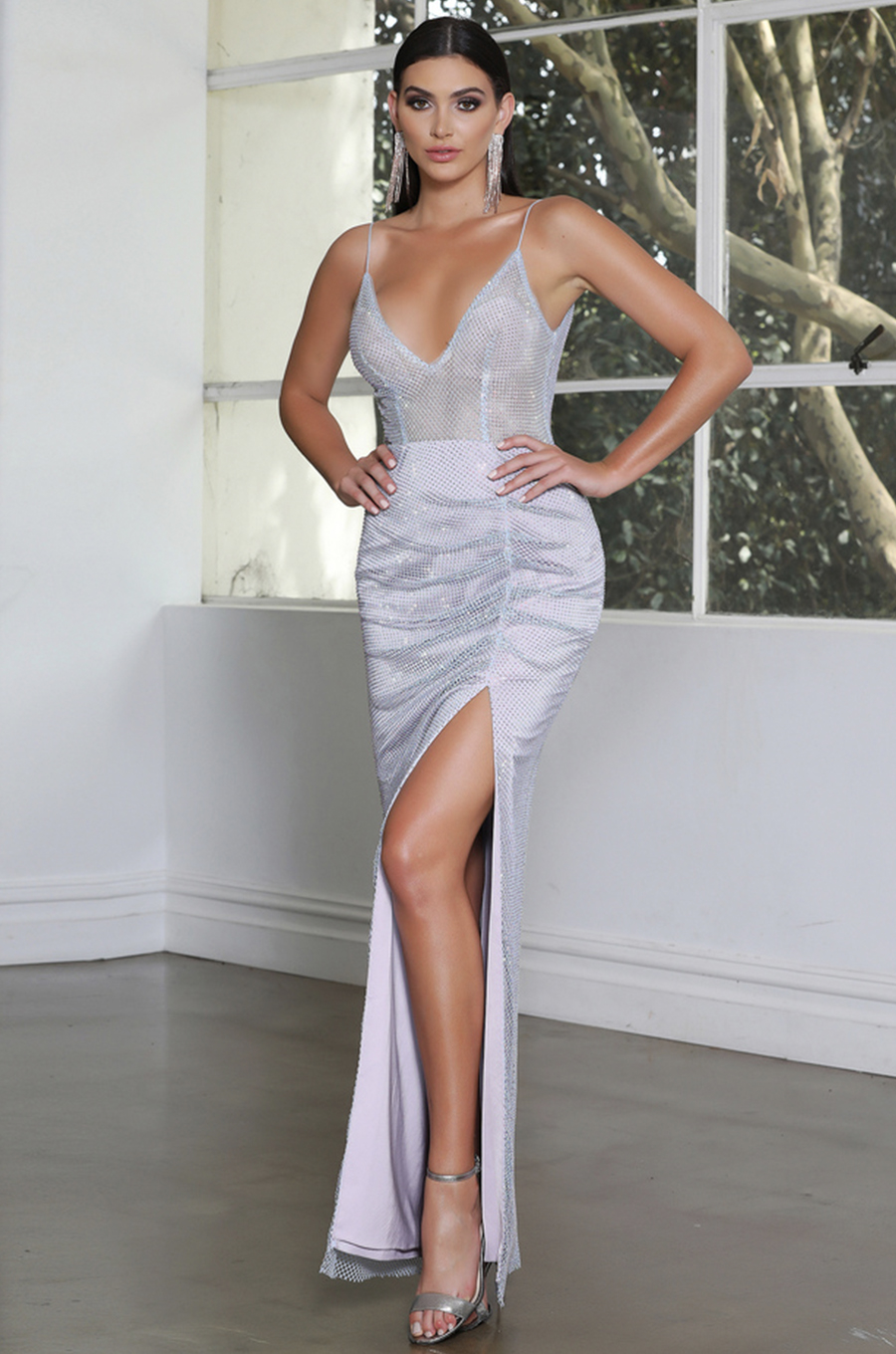 Sequin adorned v neck gown with spaghetti straps and high split