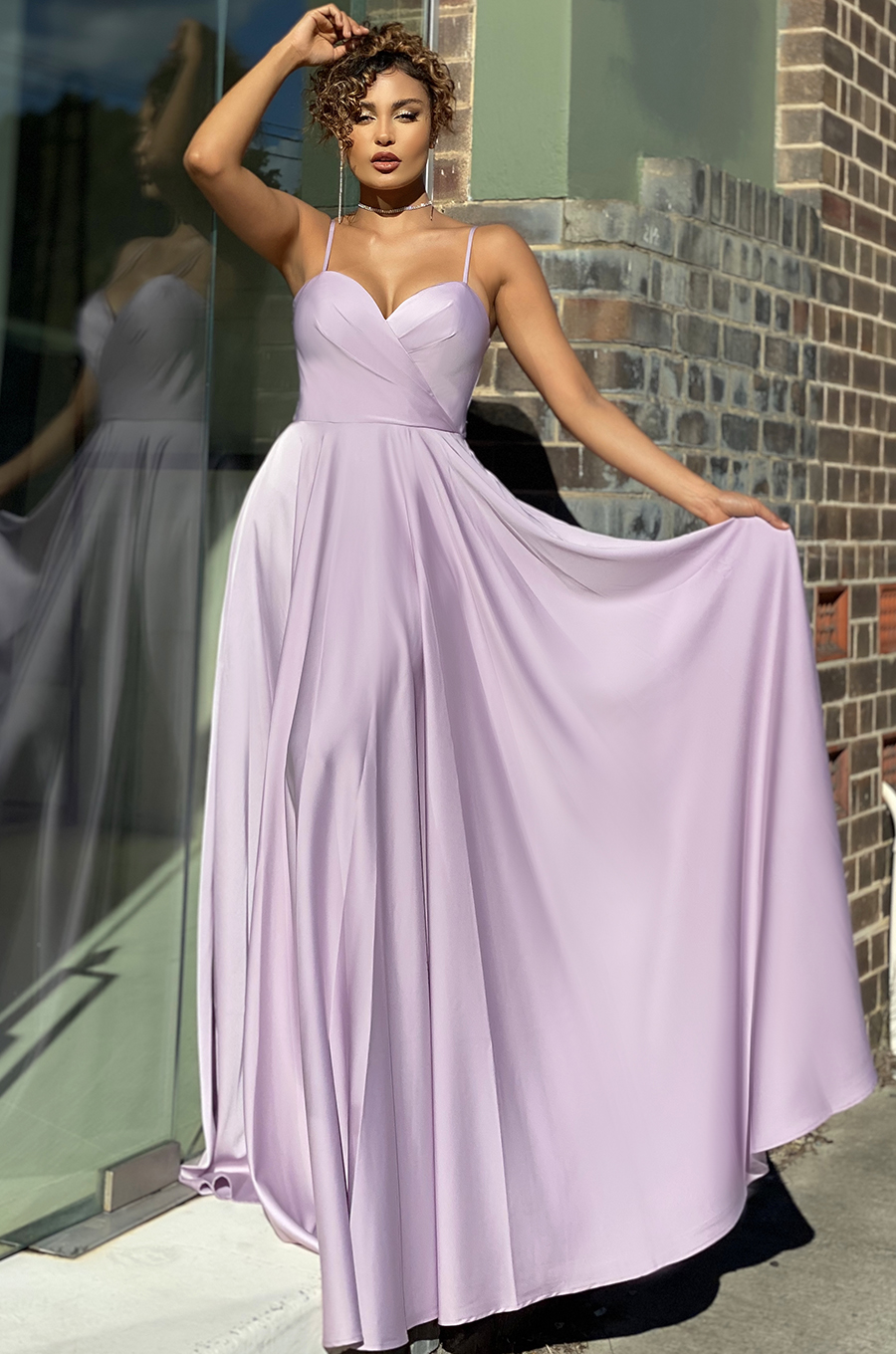 Floor-length ball gown with sweetheart fitted bodice and double straps at back
