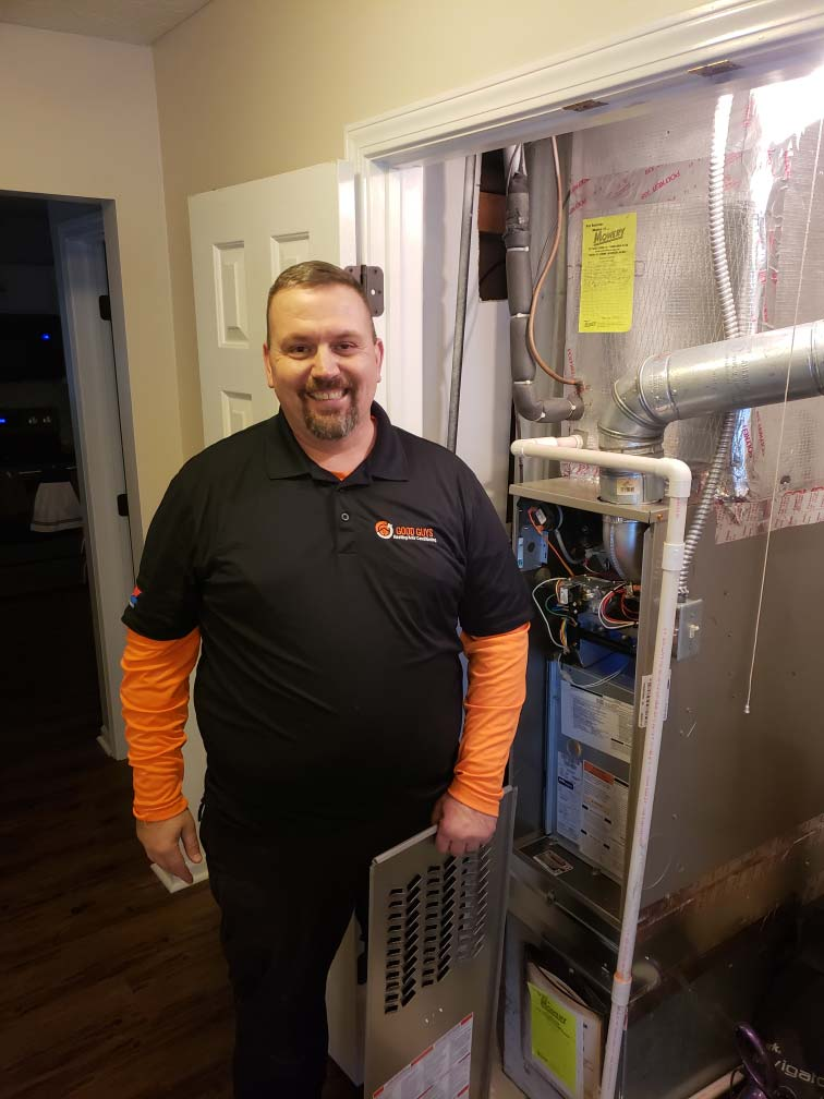 Good Guys team member with furnace