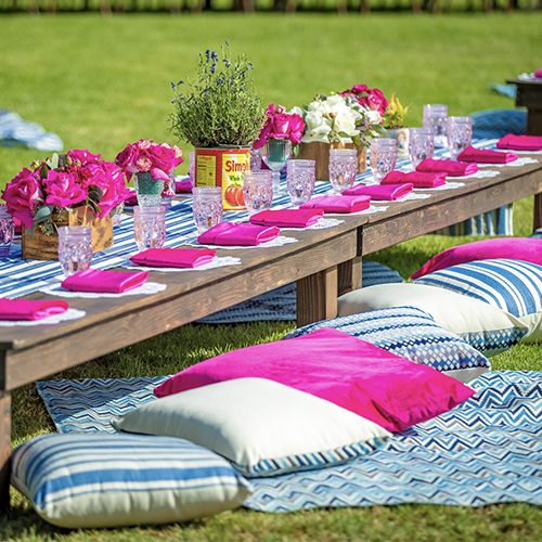 pink table set on green grass
