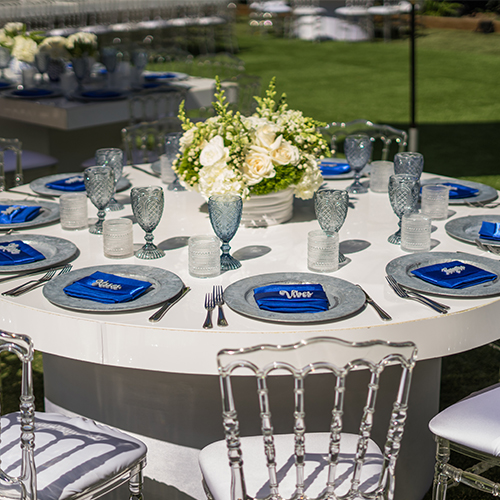 white round table set up with flowers