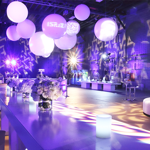 flashy lounge with balloons hanging from ceiling