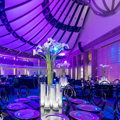 purple decor with high ceiling and light up candles