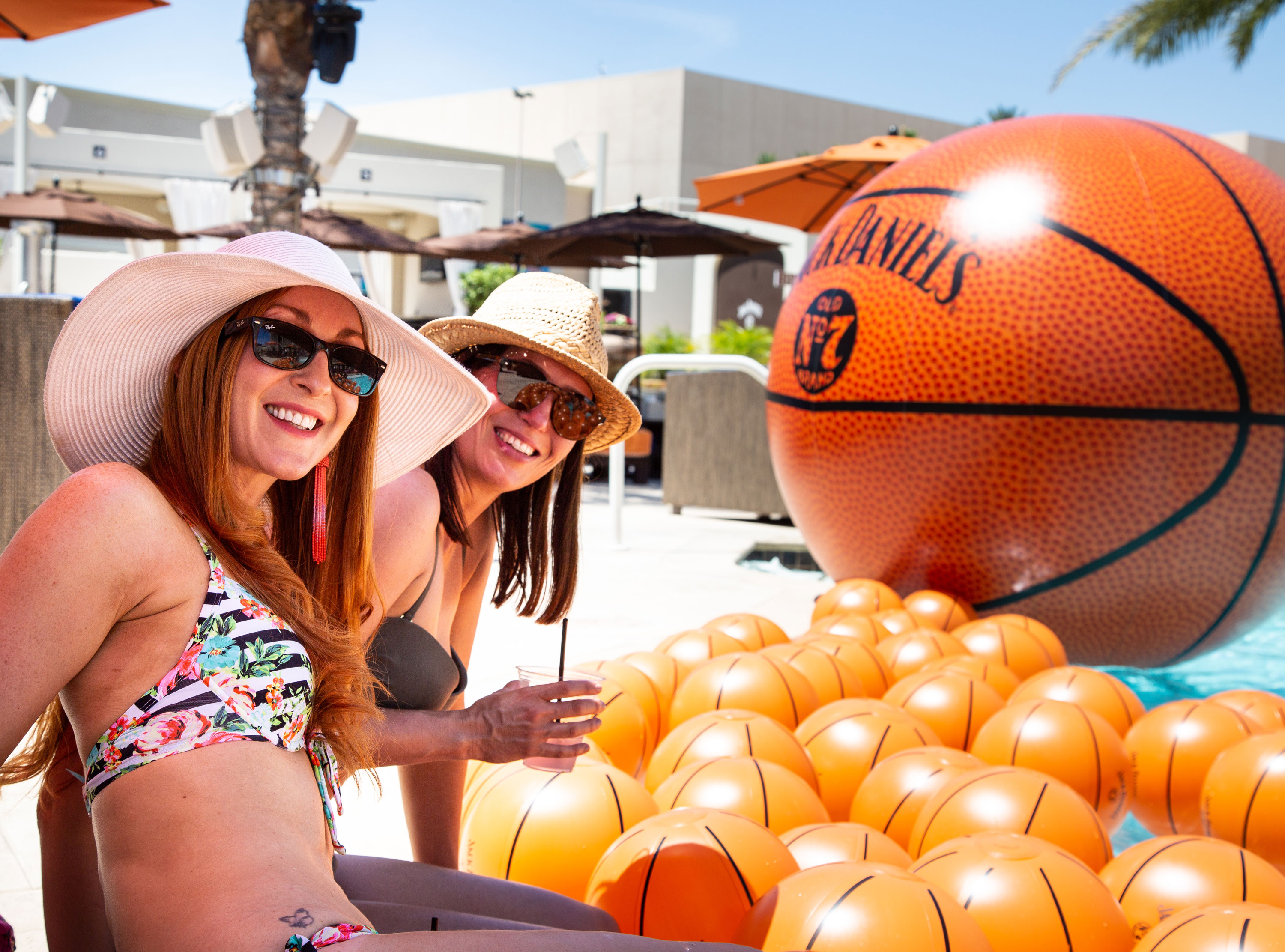 Two ladies by the pool at Jack Daniel's NBA Summer League