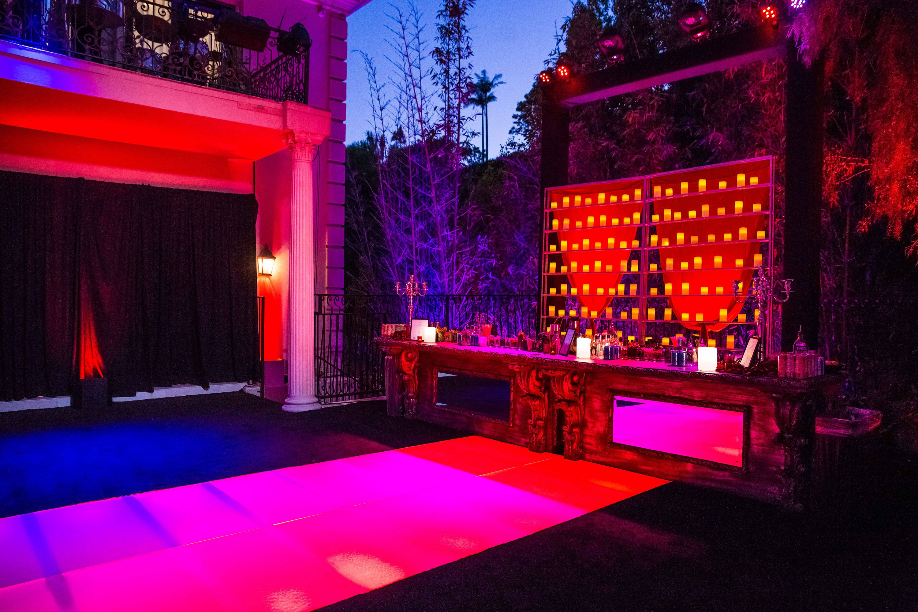 A bar with red lights at Dorit Kemsley's party