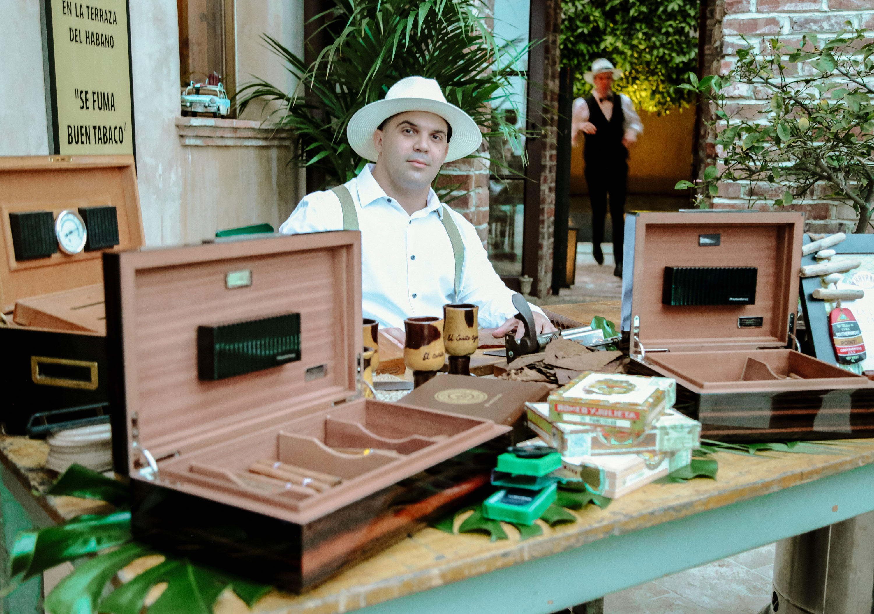 A man rolling cigars at Havana Hills Themed Party