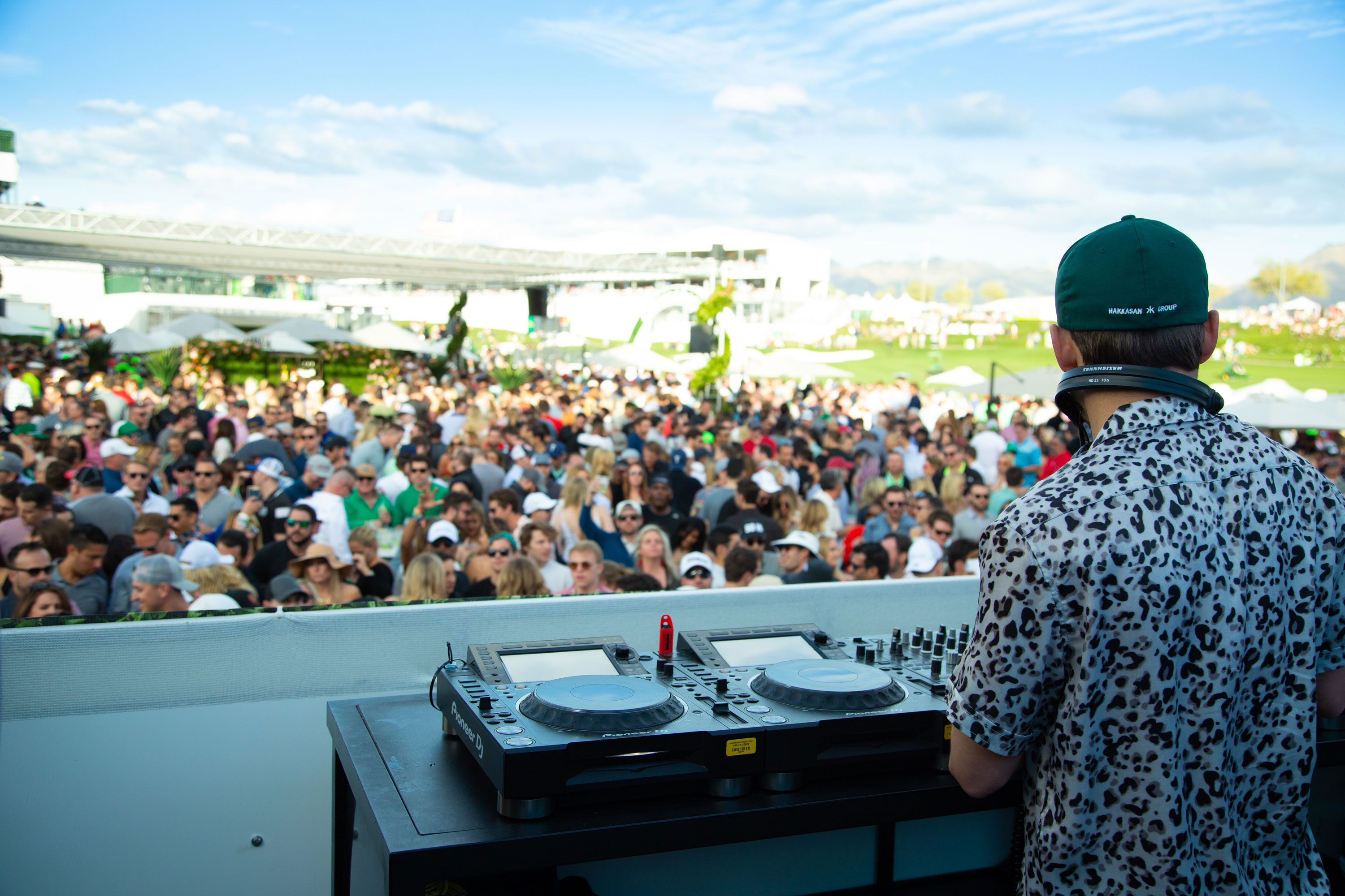 DJ playing in front of a large crowd