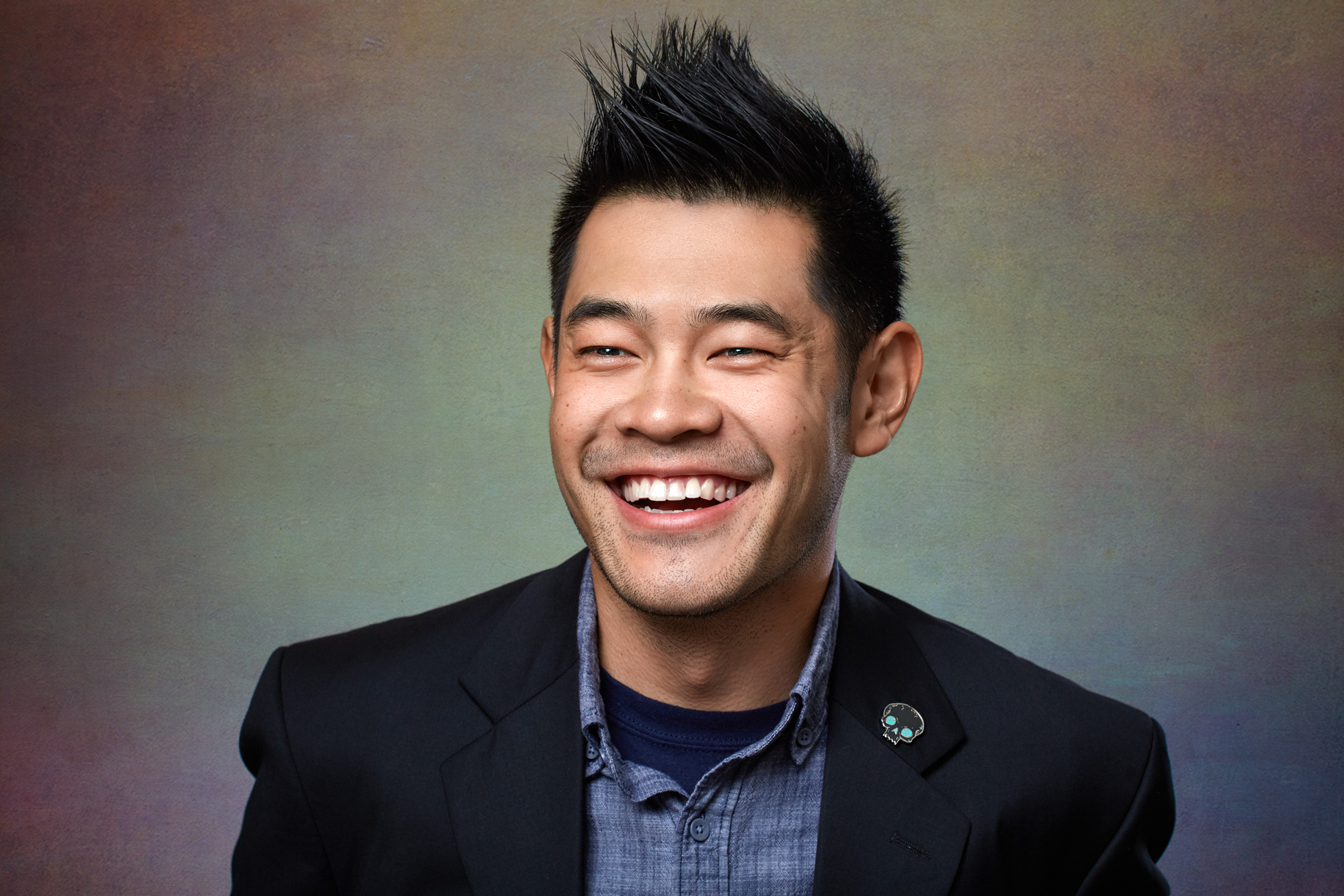 Professional Asian Man with Spiked Hair Laughing