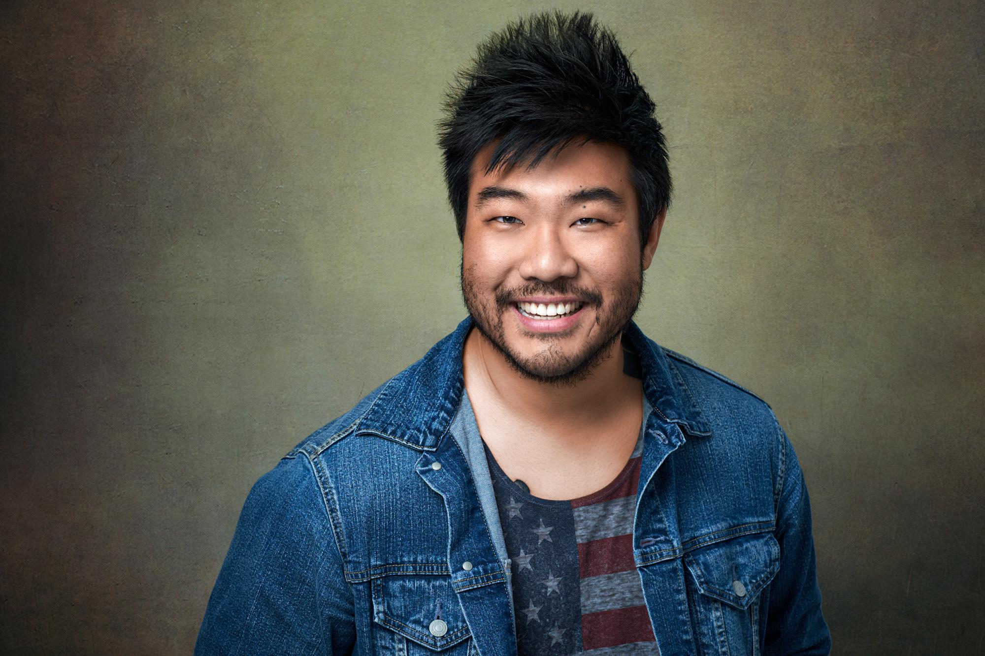 Professional Headshot Smiling Gold shirt