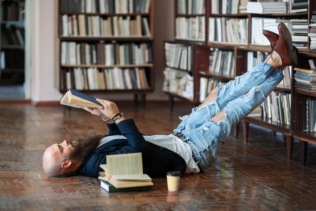 Man reading personal development book