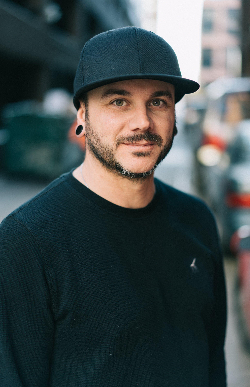 A portrait shot of Joey Mazzotta in a hat.