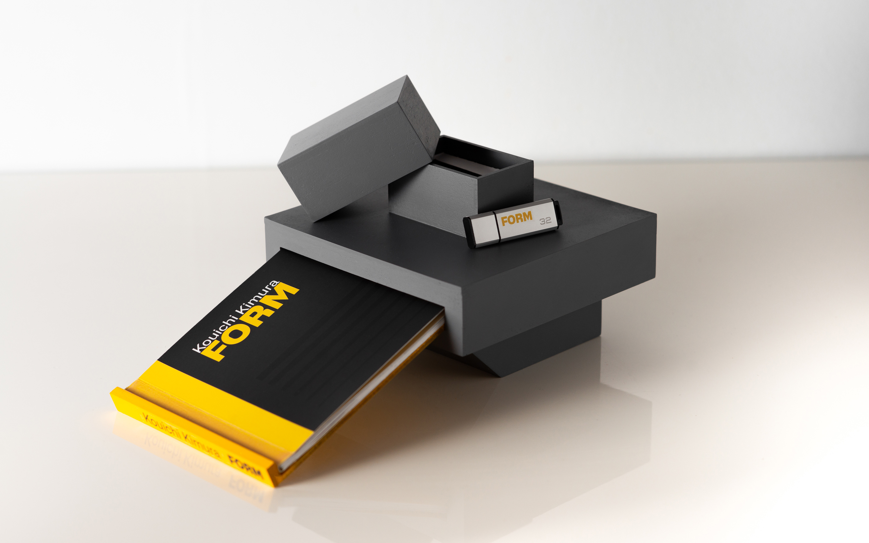 Box with Book and USB Stick