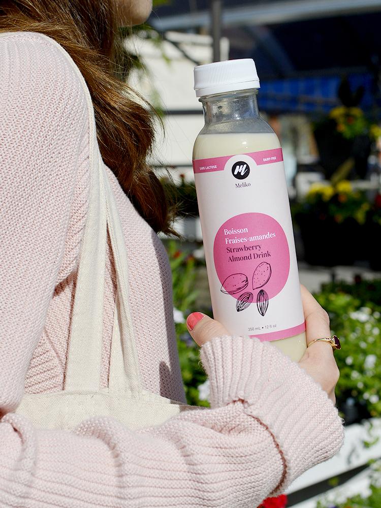 Woman holding a Meliko bottle