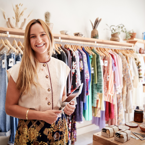 Lady smiling in clothing store image